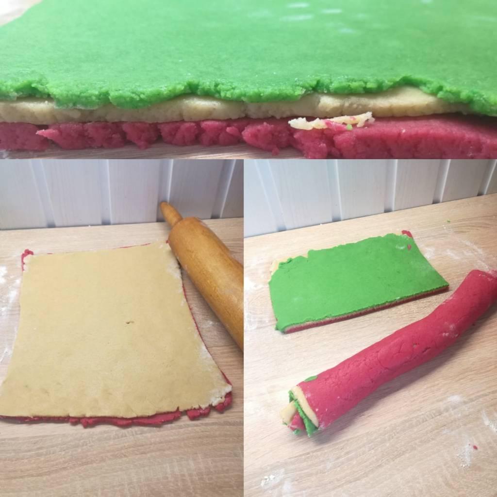 Egyenlő nagyságú tészta lapokat nyújtunk belőlük kb 0,5 cm vastagságúakat. Egymásra tesszük őket, úgy hogy a piros tészta legyen alul és a zöld legfelül.